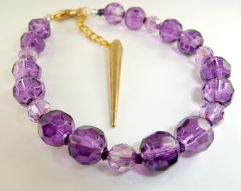Adult size purple glass bead bracelet