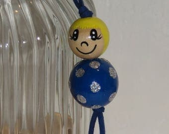 "Keychain doll with wooden beads, bag charm, ""logs smiles"" fully customizable, and hand painted bright colors"