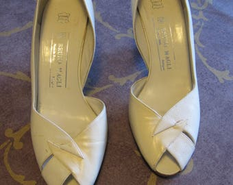 Women's white/tan high-heels shoes by Bruno Mali, Size 381/2. Very good condition