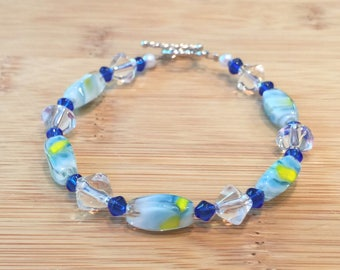 blue, white and yellow swirl glass beads with clear and blue accents
