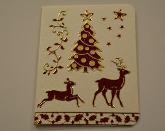 Christmas card with 2 reindeer and a Christmas tree and a Garland