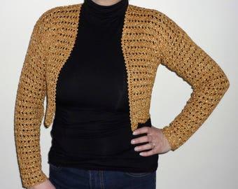 Bolero is crocheted in gold thread