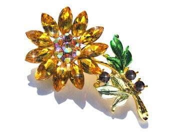Broche fleur doré cristal et strass orangé et AB.
