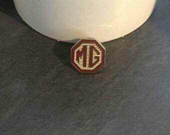 Mg pin badge