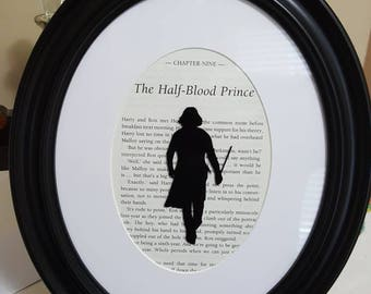 "Harry Potter Half-Blood Prince Snape silouette over original framed book chapter page. 8""×10"" plastic oval frame with matting."