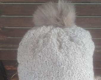 Knitted hat with real fur pom pom