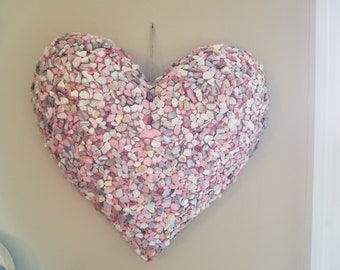 Heart with pink crushed seashells