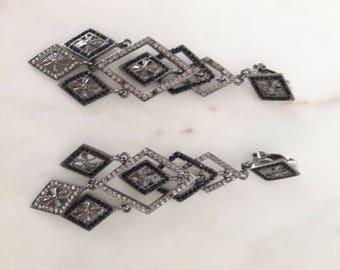 Black clip earrings