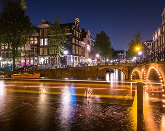 Amsterdam Canals by night - Herengracht and Blauwburgwal with light trails