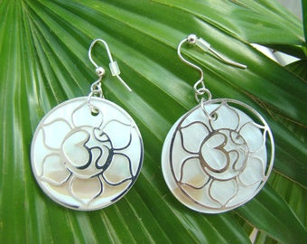 "Earrings from mother-of-pearl with a symbol ""OM"" in a Lotus."