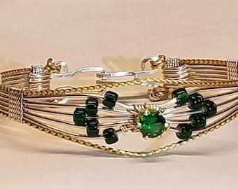 Bracelet with emerald green cubic zirconia.