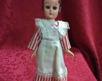 Vintage Madame Alexander doll. Brown hair and  hazel eyes.