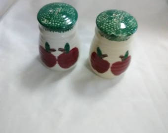 Vintage green and white apple salt and pepper shakers. Round and ceramic.