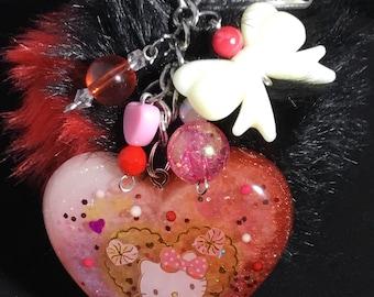 Hello kitty pom pom resin keychain/purse charm