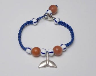 Hand-woven synthetic bracelet with nickel-free silver-plated metal whale-tail pendant and stainless steel closure