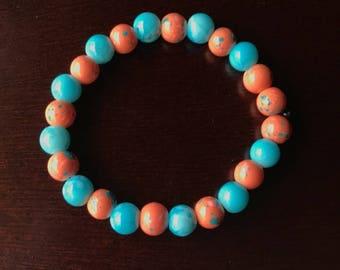 Turquoise and orange speckled beaded bracelet