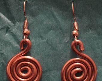 Copper coloured spiral dangly earrings