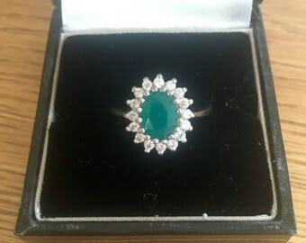 Emerald and white sapphire cluster ring