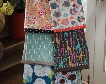 Wimsical print cozy flannel baby/toddler/adult lap blankets.