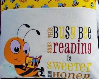 Bee reading pocket pillow