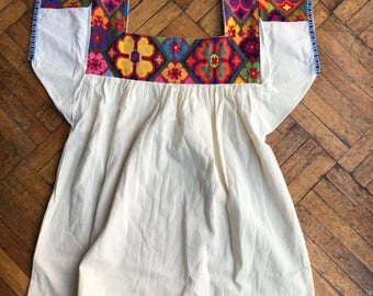 Hand embroidered blouses from Chicontepec, Veracruz.
