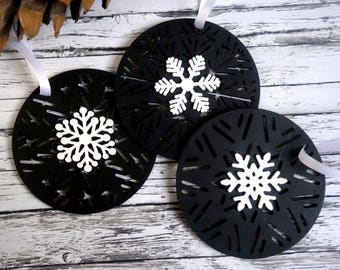 Black & white round Christmas bauble ornaments with snowflakes. Hand-painted monochrome wood tree decorations.