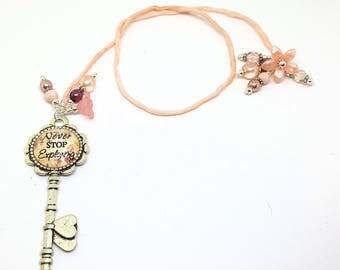 Peach Silk Cord Beaded Bookmark Book Thong Featuring Key Word Pendant Never Stop Exploring