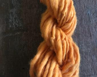 Annatto dyed, orange handspun yarn, naturally dyed local wool,  28 yards, single ply bulky weight yarn, handspun art yarn, plant dyed yarn