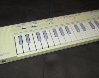 Vintage 80s Pastel Yellow Mini Casio Keyboard PT-1