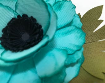 A Gorgeous Teal Colored  Three  Dimensional Paper Flower Embellishment