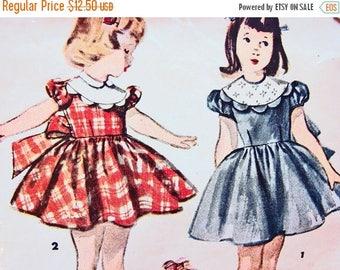 on SALE 25% Off Vintage Girls Dress Pattern size 6 Girls Puff Sleeve Dress Big Bow Scallop Edge Yoke Back Button Sewing Pattern