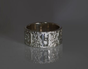 Wide silver designer contemporary ring based on the remarcable engravings Song of Songs, made in Israel.