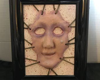 Skinned face sculpture picture