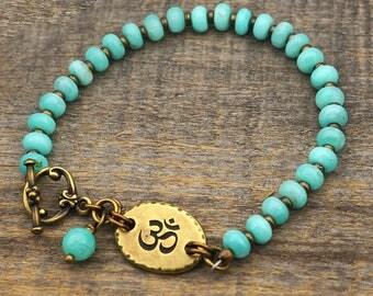 Blue brass om bracelet, amazonite zen jewelry, semiprecious stone, 8 1/4 inches long