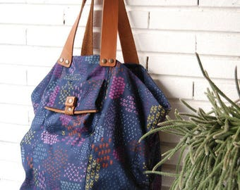 Large colorful graphics and blue fabric tote bag