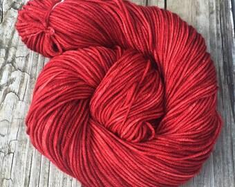Ruby Daggers Red Hand Dyed Worsted Weight Yarn Hand Painted yarn 218 yards Superwash Merino Wool treasure goddess swm blood red garnet rose