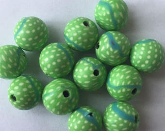 Pack of 13 x 10mm polymer clay round green with white spots beads.