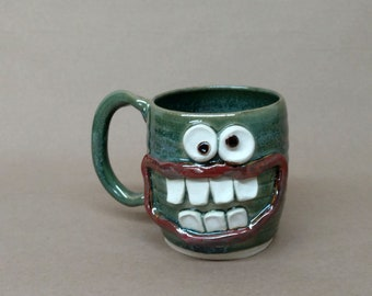 Green Pottery Coffee Cup. Average All American Man. Nelson Studio Ug Chug. Pint Size Beer Tankard. Witty Guy Gift Exchange 16 Ounces