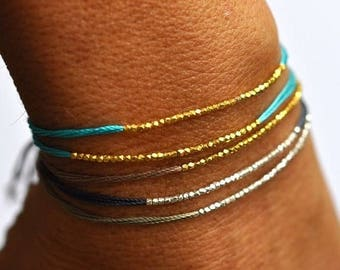SALE Gold beads on Turquoise silk friendship bracelet. Silk bracelet. Modern bracelet.