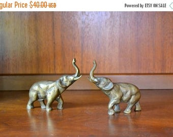 SALE 25% OFF vintage brass elephant figurines / good luck brass elephants / gold tone metal home decor