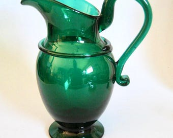 Emerald Art Glass green footed pitcher | etsy