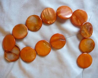Beads, Mother of Pearl, 30mm orange flat round. Sold per 15 inch strand and there are 13 beads on the strand.