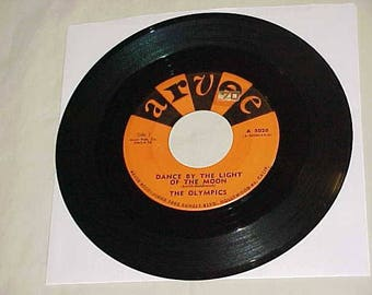 The Olympics - 45 Vinyl Record - Dance By The Light Of The Moon / Dodge City