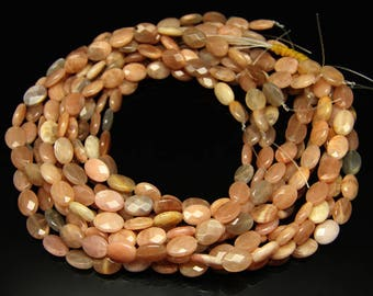 1strand - natural peach moonstone faceted oval sized 10 by 14mm