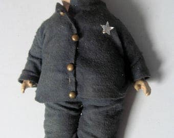 Vintage Composition cloth doll with spring legs Boy Policeman doll