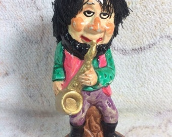 20% SALE 1970s Chalkware Steet Busker Hippy Dude Saxophone Far Out