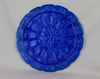 Blue glass cake plate Blue round platter Platter scalloped edge Carved Colbalt blue plate Carved apples Carved Apple blossoms Pedestal feet