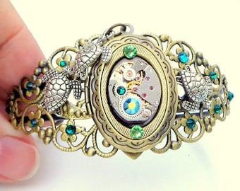 Steampunk Locket Bracelet,Sea Turtle Cuff,Ruby Jeweled Watch Movement,Green Swarovski Crystals, Filigree Cuff, Vintage Style,Steampunk Cuff