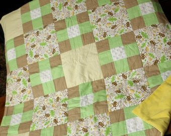 Monkeys Going Bananas baby patchwork quilt in light brown, green, yellow