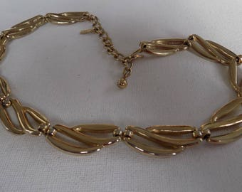 Vintage necklace, signed MONET golden flexible curvy runway necklace,designer jewelry